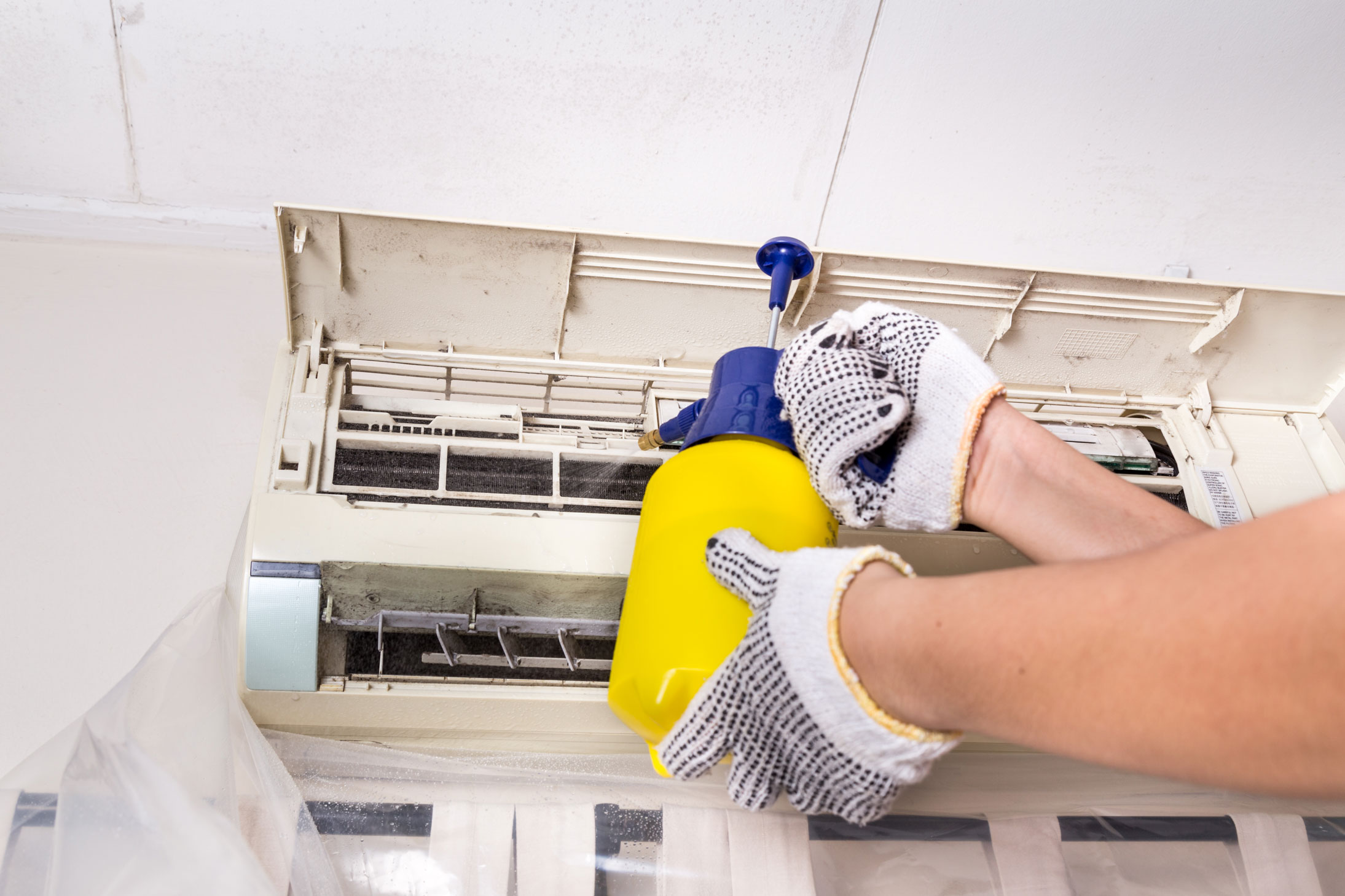 technician-spraying-chemical-water-onto-air-PPEB8PH